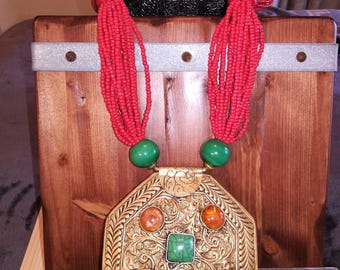 Bold and beautiful red coral beads and brass pendant statement necklace
