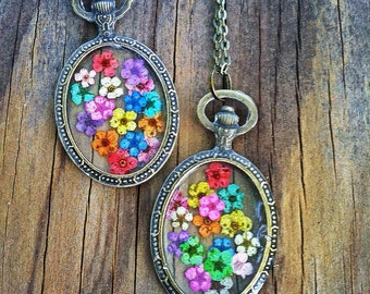 Rainbow Flower Pendant Necklace. Real flowers preserved in clear casting resin, enclosed in Vtg. Bronze Pendant. Bronze Chain.
