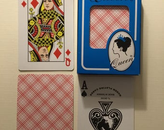 Queen, Plastic coated, red backs playing cards.