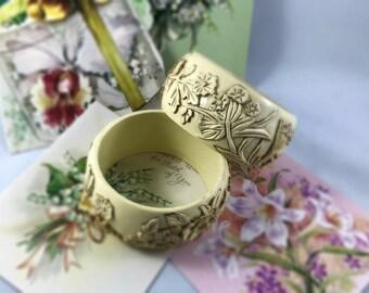 Creamy decorative plastic (celluloid?] bracelets