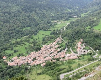 Original laminated placemat aerial view of the village of Montsegur Ariege