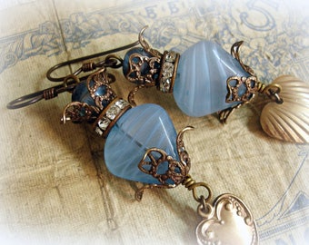 hearts aren't made to break one of a kind vintage assemblage earrings antique blue glass hearts rhinestones  vintage gold tone hearts