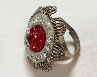 Adjustable silver ring with cherry red faux druzy and sparkling clear rhinestones.