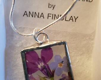 Pressed flower pendant. Lobelia and Forget-me-not.