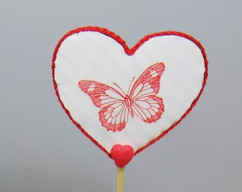 Red and white heart shaped decorative butterflies stick