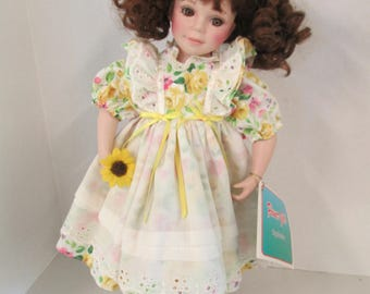 Vintage porcelain ringlet brown hair brown eyed 15 inch doll yellow flowered  dress  Flower Girl Exclusive used