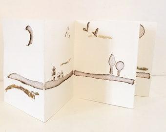 Leporello burnt paper and lace bobbin, backgrounds