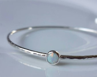 Sterling silver stacking bangle with hammered finish and white opal. Made in Wales, made to order.