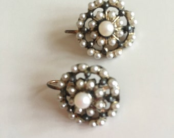Vintage earring from the 80's. They are made in Italy of sterling silver, rose gold plated