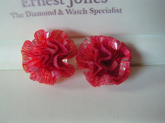 Pretty vintage 1950s frilly red lucite clip on earrings