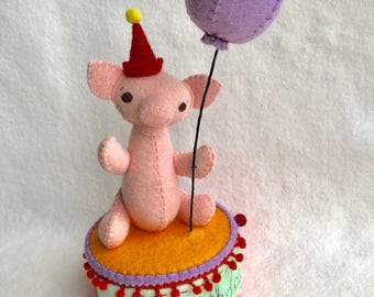 Happy Birthday music box with a party piglet holding a purple balloon