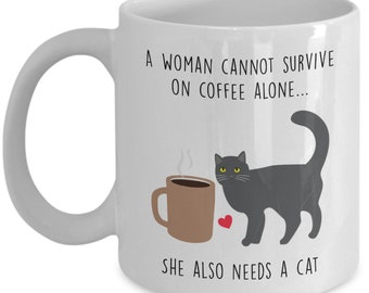A Woman Cannot Survive On Coffee Alone Mug - Cat lover Gift - Funny Tea Hot Cocoa Cup - Novelty Birthday Christmas Anniversary Gag Gifts