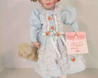 """Vintage porcelain curly blond hair blue eyed """" Julie"""" doll 15 inch blue dress with teddy bear  Collectible Memories used"""