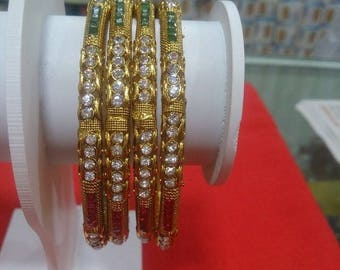 Beautiful gold plated clear glass bangles
