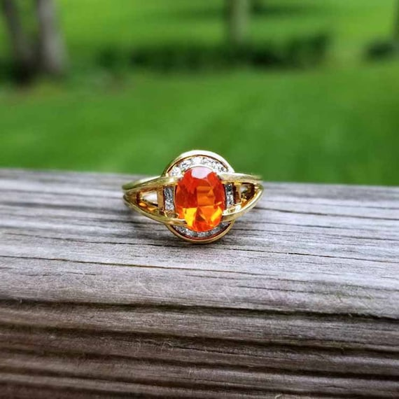 Modern estate 18k gold oval faceted orange 1 carat Mexican fire opal and fourteen channel set full cut diamond halo cocktail ring, size 7