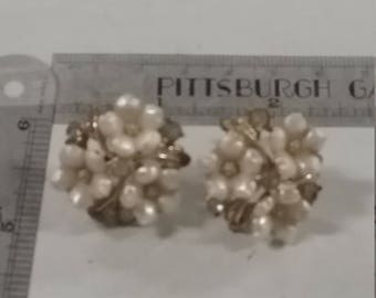 Star brand Goldtone and white plastic screwback earrings