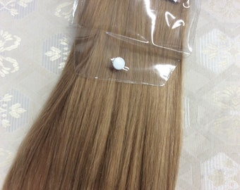 "Caramel blonde (27)  100% human hair clip in extensions   14""  18""  20"""