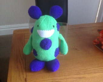 Hand knitted monster soft toy