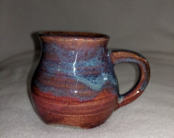 Unique pottery cappuccino cup in red and blue glaze