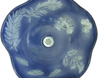 Ocean Vessel Sink with self colored leaf imprints in deepest blue.