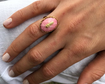 Pale pink feather ring