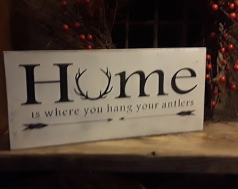"""Handmade Distressed """"Home is where you hang your antlers"""" Wooden Sign"""