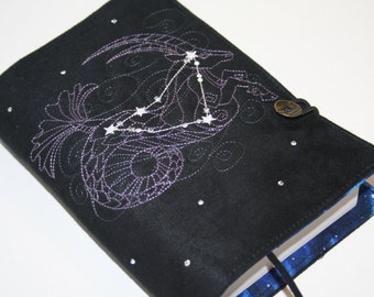 Steenbok geborduurd boekomslag