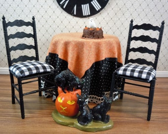 Dollhouse Miniature furniture in twelfth scale or 1:12 scale.  Skirted Halloween table with 2 chairs.  Item #138.