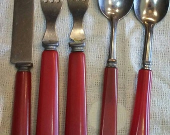 Red bakelite flatware 5 piece collection