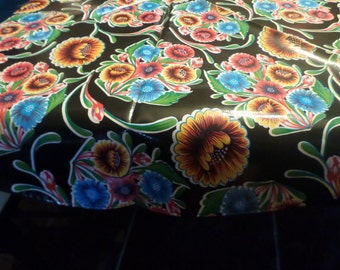 "60"" Round black flowered tablecloth"