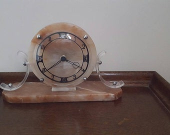 Vintage electric pink marble mantel clock with glass face and plastic maybe bakelite sides in working order