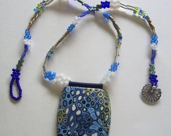 Blue, White, and Olive Square Polymer Clay Pendant and Bead Woven Necklace by Carol Wilson of PollyClayDesigns