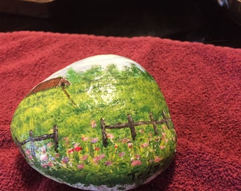 hand painted country barn scene on a rock