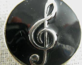 Bouton pression clé de sol (musique) noire et blanche