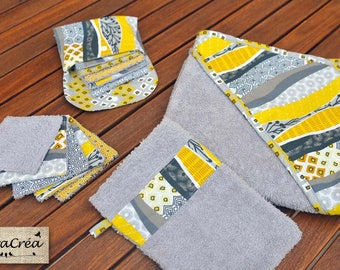 Pack of baby toiletries: cape of bath, wash cloth, wipes