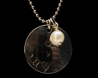 Hope, semi colon necklace with a pearl accent.