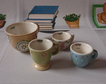 Set of miniature porcelain measuring cups. Handpainted.