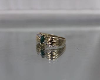 10k - .25 ctw - Diamond Accented Emerald Ring in Grooved Curved Ring in Yellow Gold