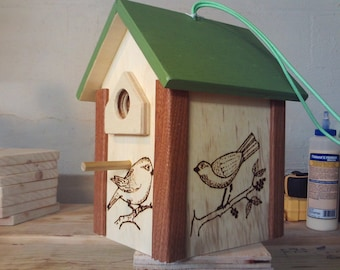 Handmade wood birdhouse with wood burned birds