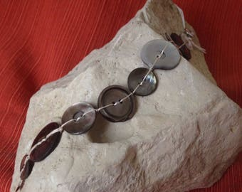 Mother of pearl button bracelet with silver clasp