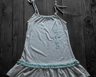 White dress with blue hearts