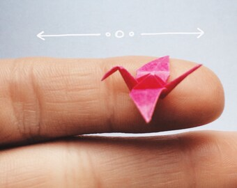 Mini origami crane in the glass