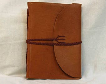 Notebook in soft leather with braided cord closure