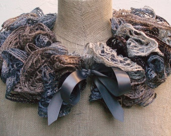 Ruffled Scarf in Beige and Gray.