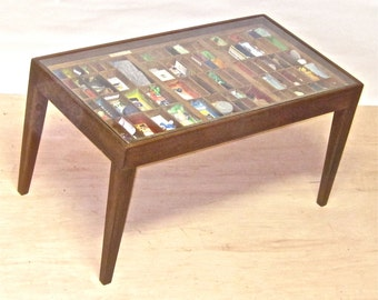 Walnut wood coffee table custom furniture for a printer's type drawer for displaying a seashell collection, jewelry collection or more.