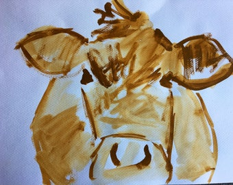 Yellow Cow on white paper