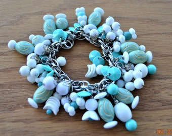Charm Bracelet,Aqua Carved Galalith  and Milk Glass Dangles,Chunky Lovely white -Ivory underneath,Many different Shaped Beads OOAK