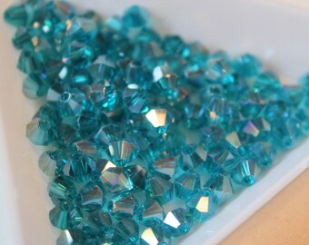 x 10 #T13 faceted bicone beads - iridescent - blue - 4mm - Crystal from Austria