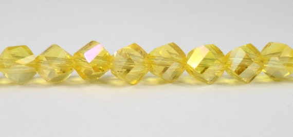 """Helix Crystal Beads 6mm Faceted Lemon Yellow AB Twisted Crystal Beads, Chinese Crystal Glass Polygon Beads on a 7 1/4"""" Strand with 33 Beads"""
