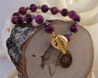 Hot pink brass charm bracelet